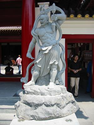 Statue outside Buddha Tooth Temple in Chinatown, Singapore